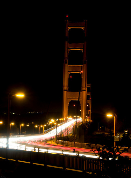 Golden Gate Bridge at night with traffic
