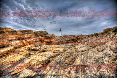 Lighthouse peeking over Striated Rock