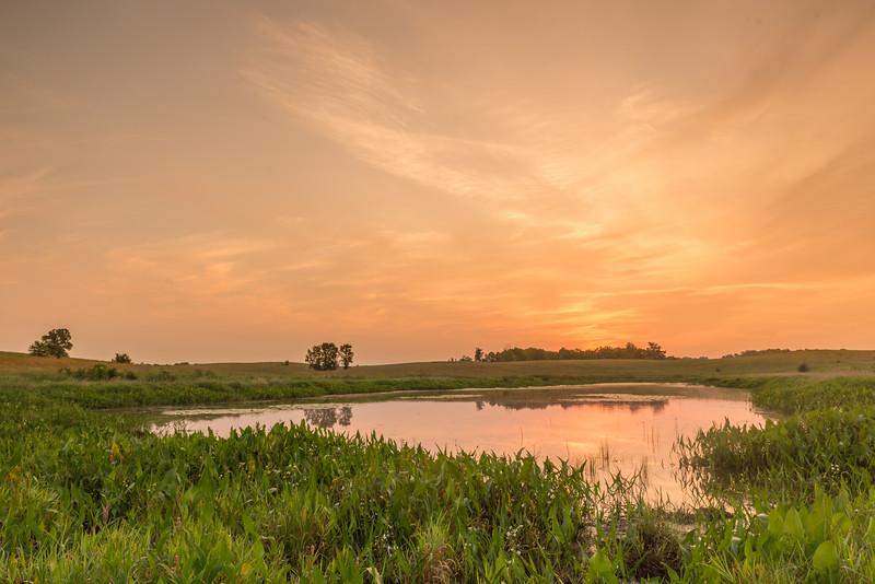 Sunrise over prairie pothole
