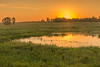 Sunrise at a prairie pothole
