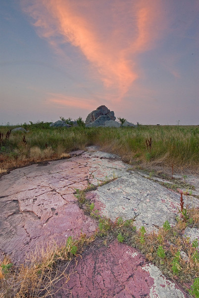 MNPR-7061 Blue Mounds St. Pk.: The sunset light was hitting this streak of clouds and I searched for a composition to take advantage of this unique light. I like how the clouds and rock in foreground was pointing to the standing rock.