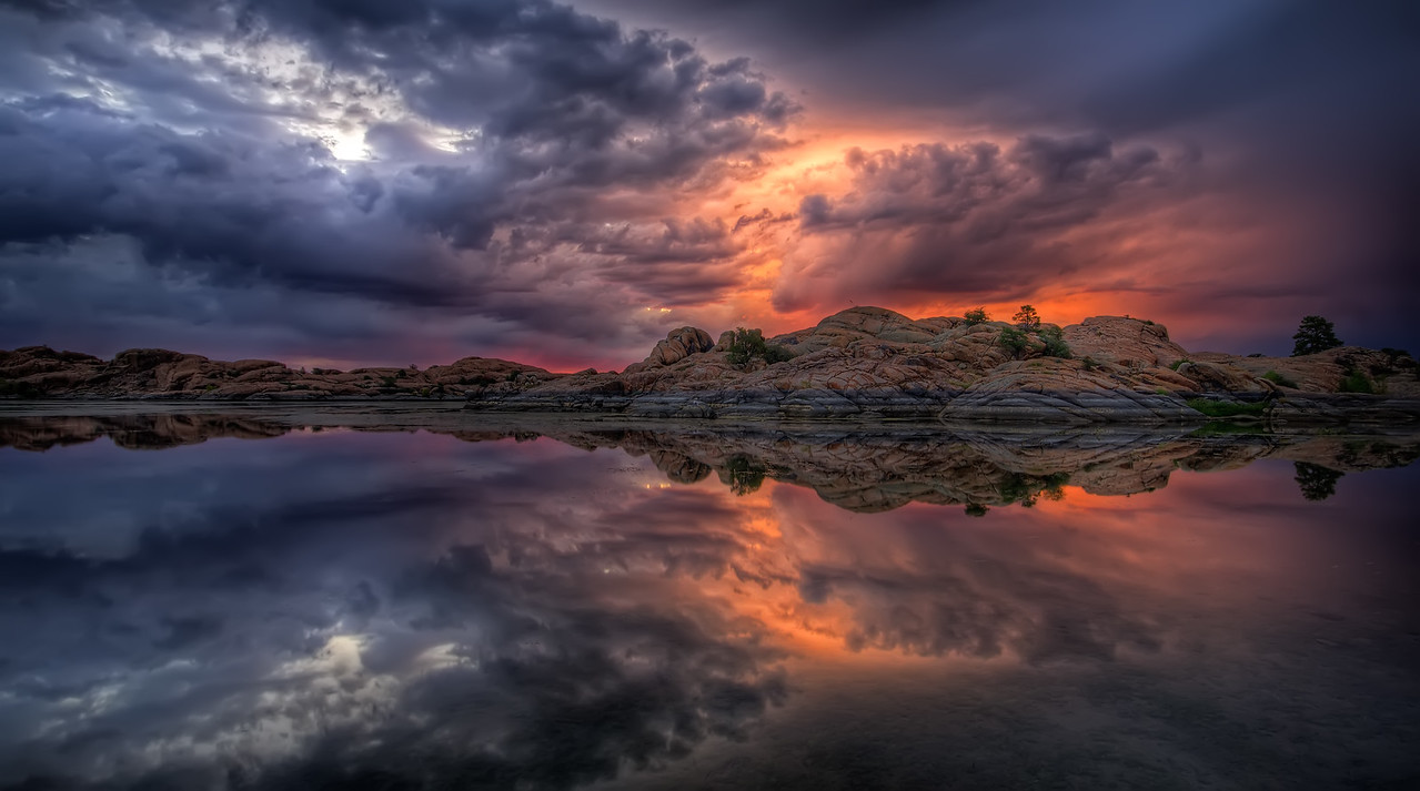 A cloudy and colorful sunrise at Willow Lake in Prescott, AZ