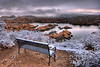 A snowy, cloudy, winter morning overlook at Watson Lake in Prescott
