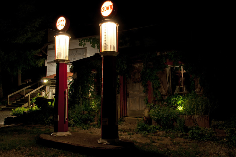 The gas pumps lit up at night in Rabbit Hash
