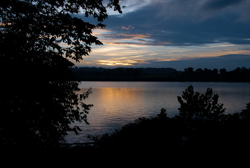 The sun sets over the Ohio river as viewed from Rabbit Hash, KY. Across the river is Rising Sun, Indiana (USA).