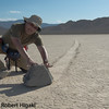 Racetrack, Death Valley : I just completed a trip to Death Valley. The most popular theory for the rock movement is the wind pushing it when the surface is wet and slippery. My theory: a bunch of wise guys coming here at night and push these rocks around. By the way, nobody has ever seen these rocks move.(*******this is a joke picture; I am pretending to push that rock*****) click on this link for possible explanation of this phenomena: http://geology.com/articles/racetrack-playa-sliding-rocks.shtml   The locals will tell you it is an all day mission. Do not show up early unless you are trying an early morning shot. I suggest you show up at the Racetrack around 2pm and scout around for the best rocks. Most of the rocks are located at the southern end of the playa. Remember: the playa is surrounded by mountains so even though the sunset is 7:30pm, lights out around 6:15pm. Thus, you do not get the warm lighting because of the mountains.