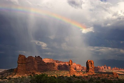 Rainbow over Balanced Rock and Windows area, La Sal mountains in background.