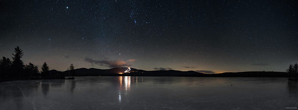 Saddleback Mountain under the stars. Lights are provided by the snowmaking crews.
