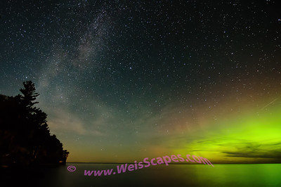Milky Way and Northern Lights over Lake Superior, Beaver Basin Wilderness area of Pictured Rocks National Lakeshore.