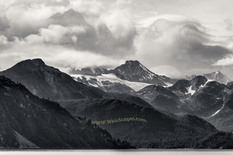 Clouds breaking up over Glacier Bay National Park, AK.