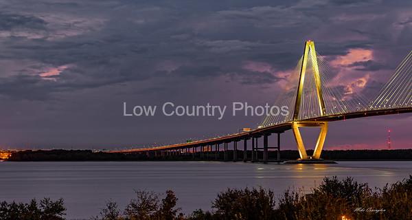 The Ravenel Bridge with purple sunset