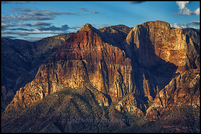 Sunrise on the face of Rainbow Mountain East Peak in Red Rock Conservation Area.