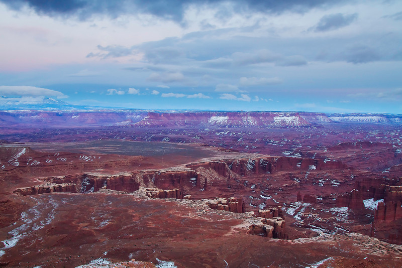 """Much of my day was a bust photographically; after a morning beneath solid white skies and no contrast to the landscapes in Arches, I headed to Canyonlands with the hope for something better.  Off and on through the afternoon, patches of sky opened up, but it really wasn't until after sunset that any real color developed,  Grand View Point is definitely an afternoon location--probably best about an hour or two before sunset itself, but with the right """"blue hour,"""" it can still stand out."""