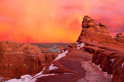 January at Arches National Park made for a cold, windy sunset at iconic Delicate Arch--but more spectacular than the last rays of the sun striking the arch itself was the sky behind the slickrock basin where Delicate Arch is perched.