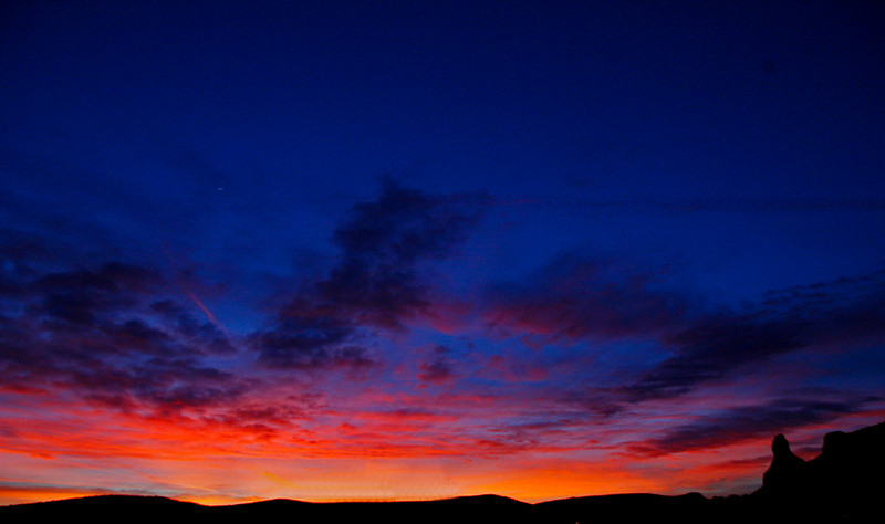 Big Arizona Sunset with spire of House Mt
