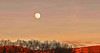 Sunset skyline with moon