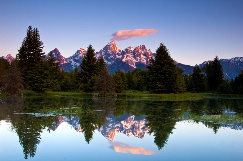 "Schwabacker Landing - Teton National Park.  MY FAVORITE PHOTO!!!! I've been ""chasing"" another opportunity like this since.  This was taken during my first ""official"" attempt at serious photography.....Waited since 4:30 am for this shot at 6:20 am.....on certain days, god just drops that little cloud over the top of the mountain....I've been beck 9 times to that same spot but never had an opportunity to see it like this"