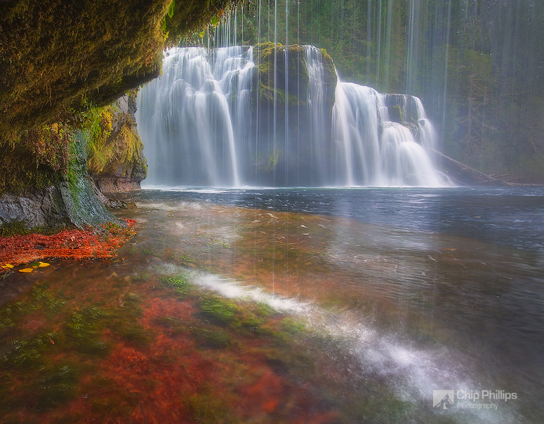 """""""Lewis River Falls Cave""""  Lower Lewis River Falls shot from behind a waterfall  on a rainy autumn evening."""