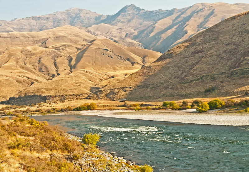 Soft fall colors surround Captain John Rapids on the Snake River