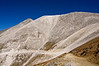 A hiker appears as a tiny speck in the vast landscape of Mount Antero's west face; Colorado Sawatch Range.