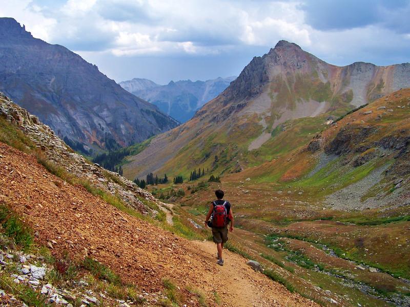 Hiker descending the Mt. Sneffels trail, Colorado San Juan Range.