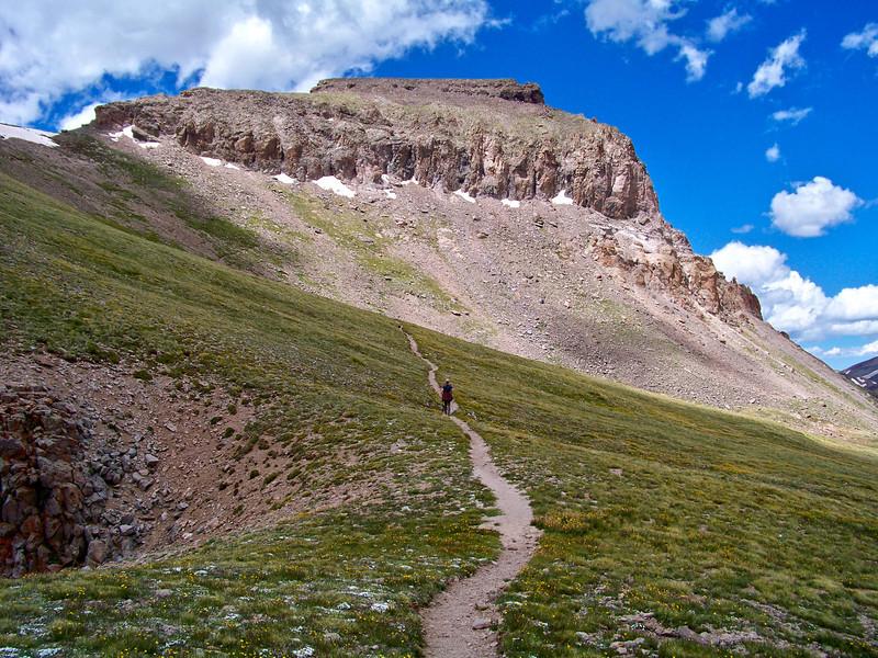Hiker approaching the southest ridge of Uncompahgre Peak, Colorado San Juans