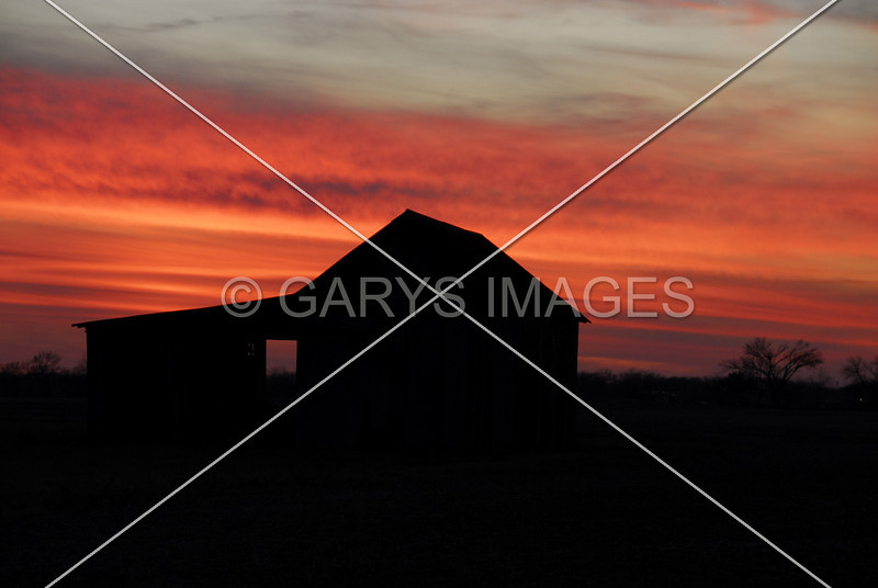 RED SKY OVER AN OLD BARN