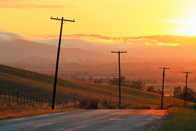 Sun setting on a rural road. Hollister, CA.