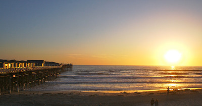 Walking along Pacific Beach at sunset near Crystal Pier in San Diego