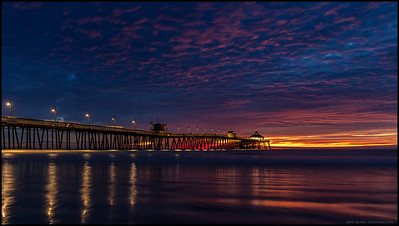 Yesterday's clouds had all the makings of an sky covering parade of colors but in the end, only a small portion caught fire.  Taken at the Imperial Beach Pier well after sunset with a rising tide.