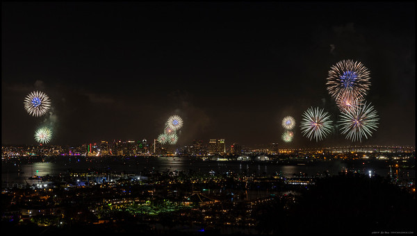 Spiky balls of colored light above San Diego Bay during the 2019 Big Bay Boom.
