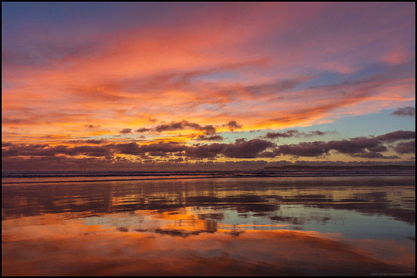 Even the line of low clouds along the coast could not stop the fire atop a glasslike beach.  Taken on Gator Beach in Coronado, CA.