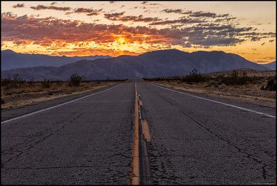 The lonely road to the San Ysidro mountains and the setting sun.