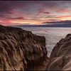 The band of clouds off the coast was no match for the colors over the cliffs last evening.