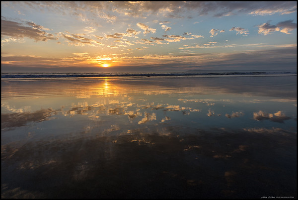 Even with the low cloud bank off the coast, the sunset coupled with a low tide made for some nice reflections.