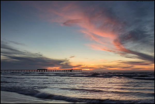The tide had started to come back in as the colors briefly popped over the Ocean Beach Pier.