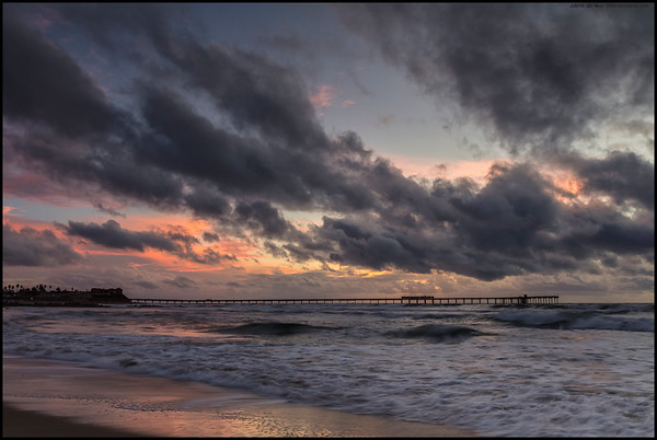 Ocean Beach pier under storm colors.