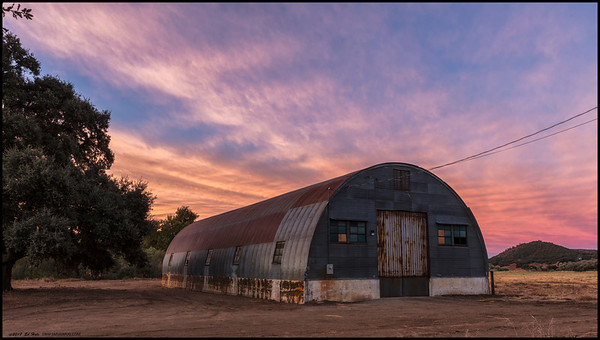 Sunrise in Descanso over an old Quonset barn.