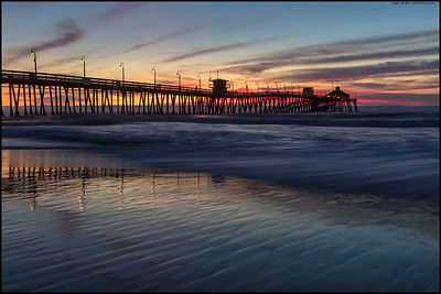 The last of the sunset colors as the tide comes in at the Imperial Beach Pier.