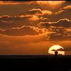 Sun setting behind a life guard tower at Ocean Beach.