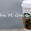 Coffee cup resting on pier railing - Ocean Beach, San Diego, California