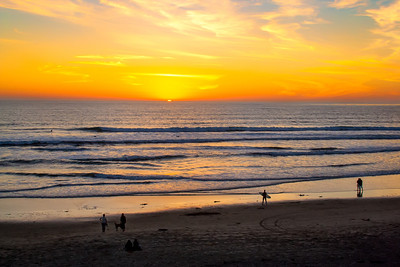 Surfer Watches Sunset