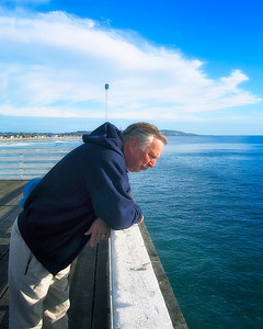 Johnny Zidek looks over the rail of the Crystal Pier in San Diego