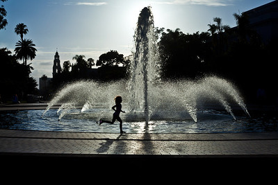 A child running around the fountain at the Reuben Fleet Center in Balboa Park.
