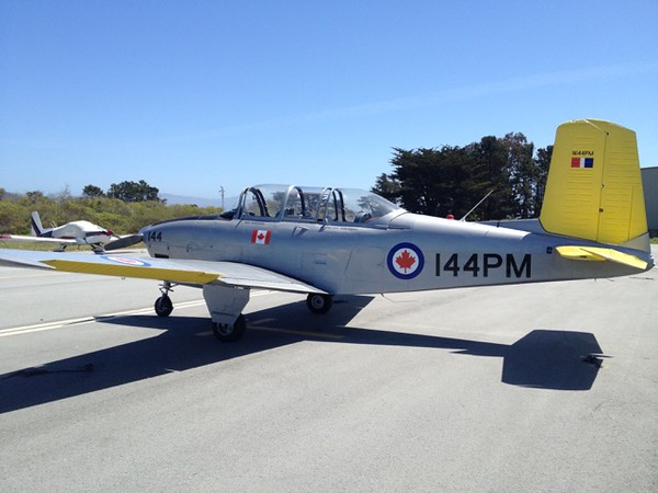 Shooting from the back of the T34 airplane!  Aerial photography at its best.  T34 in Half Moon Bay, California