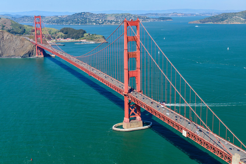 """""""Flying over the Golden Gate Bridge"""" An amazing clear day in San Francisco flying over the Golden Gate Bridge in an R44 Helicopter! Just an amazing sight to see hanging out the helicopter with no doors on it! You don't get to see this view very often! Quite the trip!"""