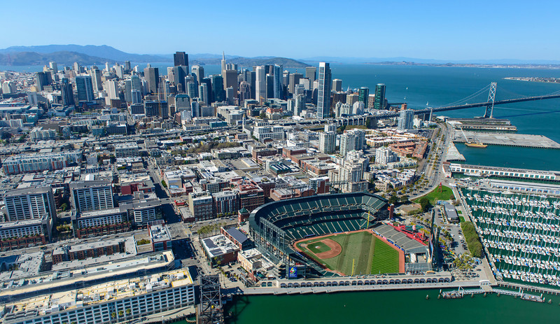 """San Francisco from the Sky with the San Francisco Giants and Bay Bridge"" San Francisco Giants Baseball Stadium Aerial View. It is opening week for baseball so I figured an aerial shot of AT&T Park, the San Francisco skyline and Bay Bridge was appropriate! Any baseballs fans here or anyone going to a game?! Quite a view from above on a clear day! I love all those boats lined up at the marina. Feel free to share with other folks and have a great weekend!"