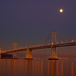 """Moonbeam"" San Francisco-Oakland Bay Bridge and almost full moon. Yerba Buena Island is in the picture."