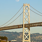 San Francisco Bay Bridge and Oakland Hills with a Moonrise with an almost full moon.  D3X8171