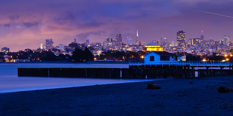 7/15 San Francisco at Night from Crissy Field.  I finally got around to making a new daily image!   Love the purple hues at dusk with this clearing storm.  The lights are just starting to glow and the Palace of Fine Arts is glowing in the middle.